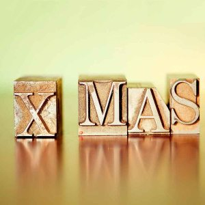 X-MAS spelled out with letter press blocks